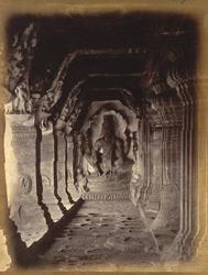 View looking towards sculpture (Vishnu seated on coiled serpent) at east end of verandah of Cave III, Badami